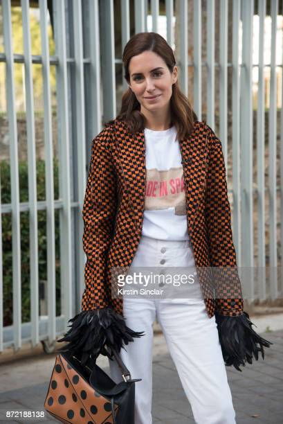 Fashion blogger Gala Gonzalez wears a Loewe T shirt jacket and bag Vintage jeans day 4 of Paris Womens Fashion Week Spring/Summer 2018 on September...