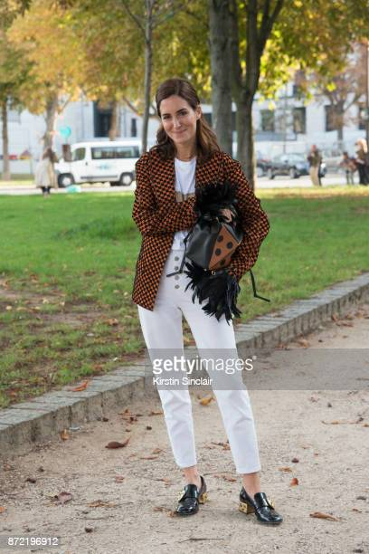 Fashion blogger Gala Gonzalez wears a Loewe T shirt jacket and bag Vintage jeans and Prada shoes day 4 of Paris Womens Fashion Week Spring/Summer...