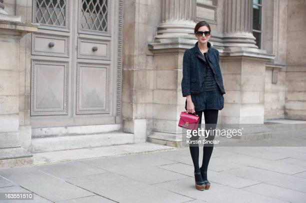 Fashion Blogger Gala Gonzalez wears a Louis Vuitton suit bag and top Top Shop shoes and Jimmy Choo sunglasses on day 7 of Paris Womens Fashion Week...