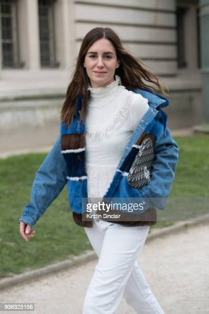 Fashion blogger Gala Gonzalez wears a Simonetta Ravizza jacket Dior bag Rochas top Mango jeans day 3 of Paris Womens Fashion Week Spring/Summer 2018...