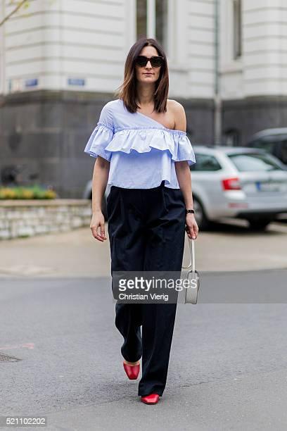 Fashion blogger Golestaneh MayerUellner wearing blue sleveless blouse from Zara black wide pants from Kenzo beige Celine bag Celine sunglasses red...