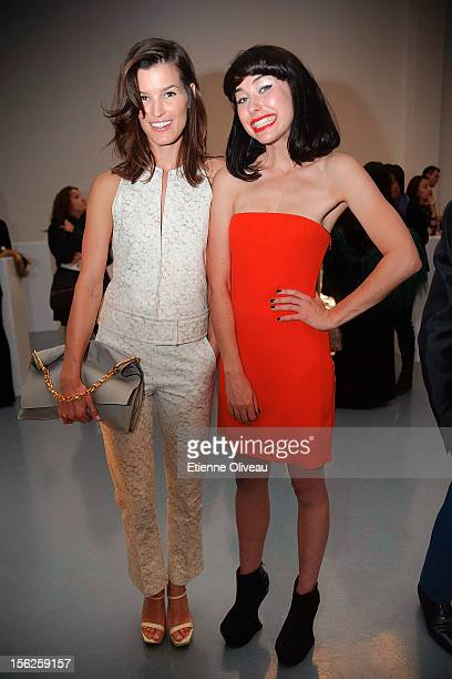 Fashion blogger Hanneli Mustaparta and Singer Kimbra pose for pictures during the Calvin Klein special dinner at the Long March Space in 798 Art...