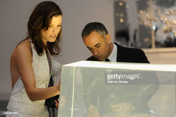 Fashion Blogger Hanneli Mustaparta and Women's Creative Director of Calvin Klein Francisco Costa view a piece of artwork during the Calvin Klein...