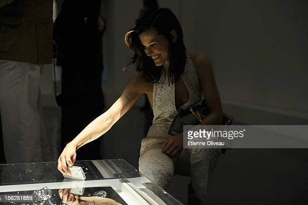 Fashion Blogger Hanneli Mustaparta views some artwork during the Calvin Klein special dinner at the Long March Space in 798 Art District on November...