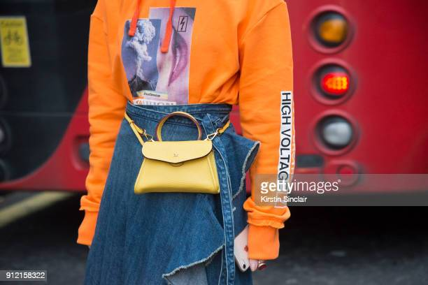 Fashion blogger Harper Silin wears a Blood Brother for River Island sweater DB David bag JW Anderson skirt day 3 of London Mens Fashion Week...