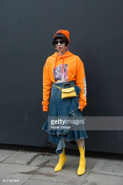 Fashion blogger Harper Silin wears a Blood Brother for River Island sweater and hat DB David bag JW Anderson skirt Zara boots and sunglasses from...