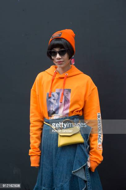 Fashion blogger Harper Silin wears a Blood Brother for River Island sweater and hat DB David bag JW Anderson skirt and sunglasses from China day 3 of...