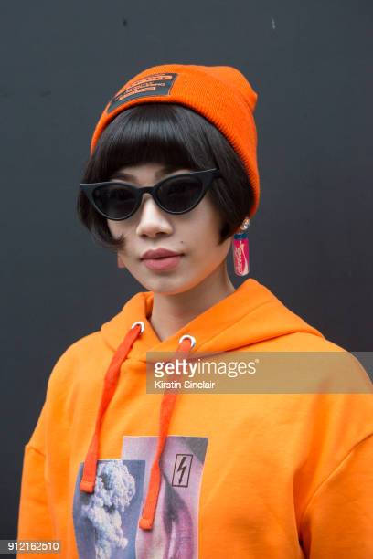 Fashion blogger Harper Silin wears a Blood Brother for River Island sweater and hat and sunglasses from China day 3 of London Mens Fashion Week...
