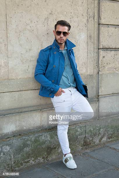 Fashion blogger Hass Murad wears Valentino shoes Ermenegildo Zegna sunglasses Nudi jeans General shirt and a George Jreige jacket on day 1 of Paris...