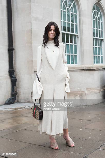 Fashion blogger Hedvig Opshaug wears a Diogo Miranda dress and shirt Gucci bag and shoes on day 4 during London Fashion Week Autumn/Winter 2016/17 on...