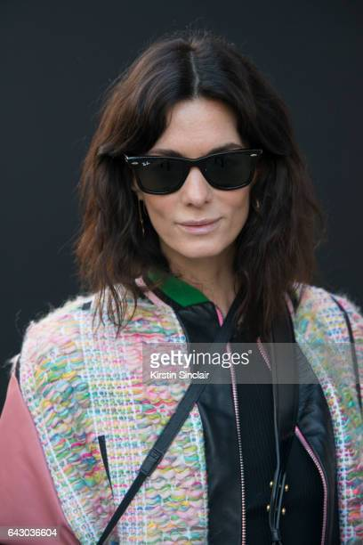 Fashion Blogger Hedvig Opshaug wears a Roberta Einer jacket and RayBan sunglasses on day 1 of London Womens Fashion Week Autumn/Winter 2017 on...
