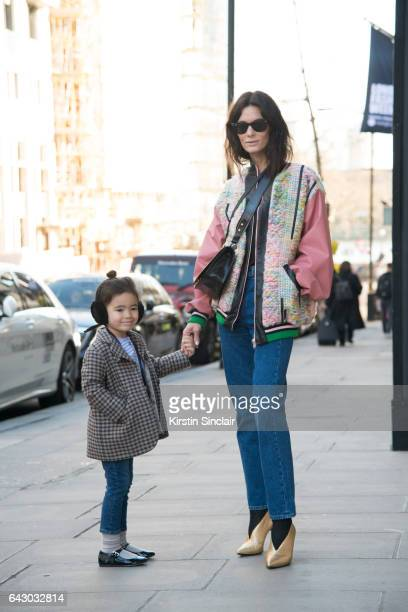 Fashion Blogger Hedvig Opshaug wears a Roberta Einer jacket Balenciaga jeans Aeyde shoes Prada bag and RayBan sunglasses with her daughter Hedda on...