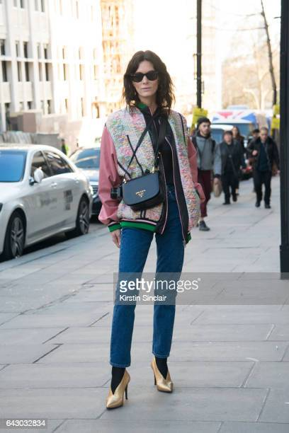Fashion Blogger Hedvig Opshaug wears a Roberta Einer jacket Balenciaga jeans Aeyde shoes Prada bag and RayBan sunglasses on day 1 of London Womens...