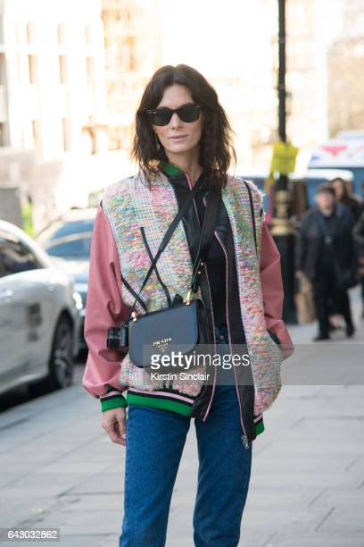 Fashion Blogger Hedvig Opshaug wears a Roberta Einer jacket Balenciaga jeans Prada bag and RayBan sunglasses on day 1 of London Womens Fashion Week...