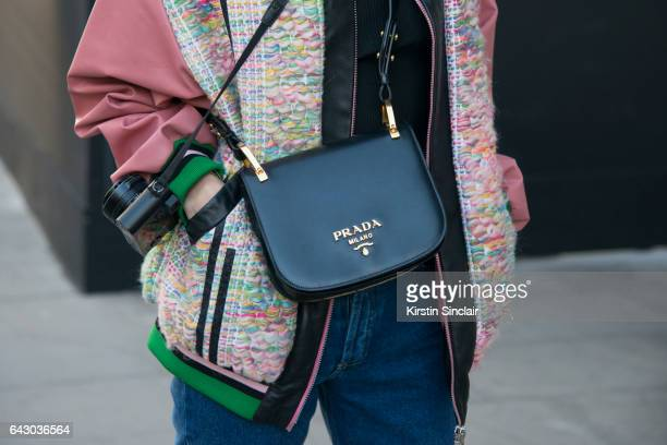 Fashion Blogger Hedvig Opshaug wears a Roberta Einer jacket Balenciaga jeans Prada bag on day 1 of London Womens Fashion Week Autumn/Winter 2017 on...