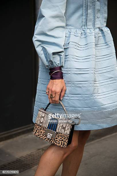 Fashion blogger Hedvig Opshaug wears a Roksanda Illincic dress and a Jimmy Choo bag day 4 of London Womens Fashion Week Spring/Summer 2016 on...