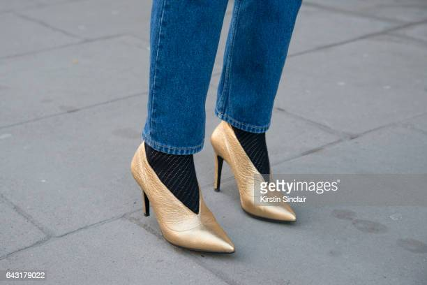 Fashion Blogger Hedvig Opshaug wears Balenciaga jeans and Aeyde shoes on day 1 of London Womens Fashion Week Autumn/Winter 2017 on February 17 2017...