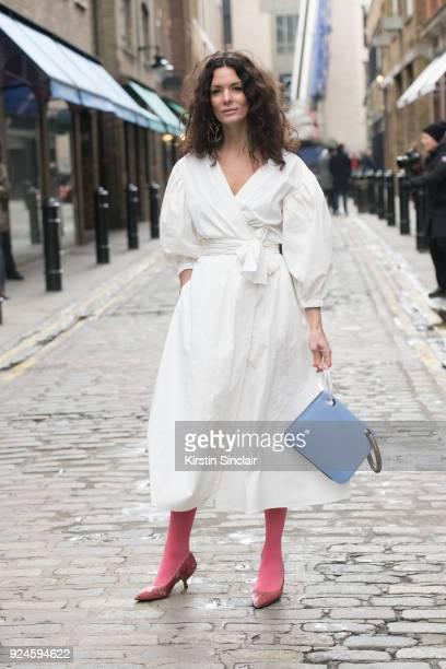 Fashion Blogger Hedvig Sagfjord Opshaug wears a Rejina Pyo dress Since oslo shoes and a Roksanda Ilincic bag on day 5 of London Womens Fashion Week...