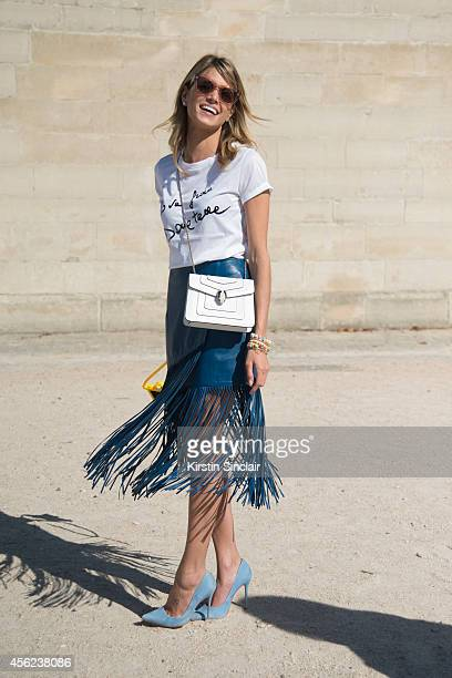 Fashion Blogger Helena Bordon is wearing Lilly Sarti skirt Versace top Bulgari bag Schutz shoes and Miu Miu sunglasses on day 4 of Paris Collections...