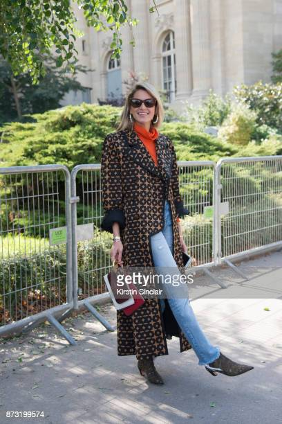 Fashion blogger Helena Bordon Meireles wears a Fendi coat and bag Dior shoes Helena Bordon sunglasses and Moussy jeans day 4 of Paris Womens Fashion...
