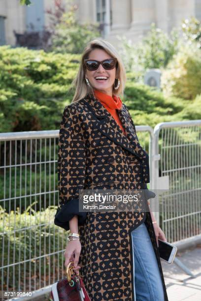 Fashion blogger Helena Bordon Meireles wears a Fendi coat Helena Bordon sunglasses and Moussy jeans day 4 of Paris Womens Fashion Week Spring/Summer...
