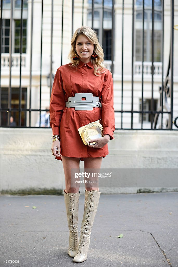 Fashion blogger Helena Bordon poses wearing a Tod's outfit, Charlotte Olympia clutch and Miu Miu shoes before Atelier Versace show on July 6, 2014 in Paris, France.