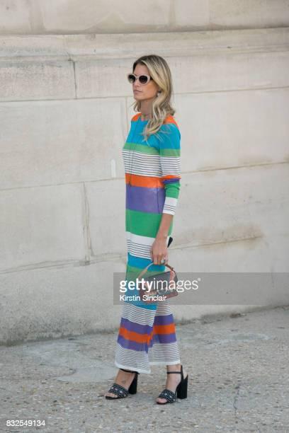 Fashion blogger Helena Bordon wears a Diana Von Fusternberg dress Tabitha Simmons shoes Helena Bordon sunglasses and a Paula Cademartori bag day 2 of...