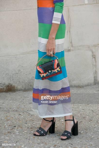 Fashion blogger Helena Bordon wears a Diana Von Fusternberg dress Tabitha Simmons shoes and a Paula Cademartori bag day 2 of Paris Haute Couture...