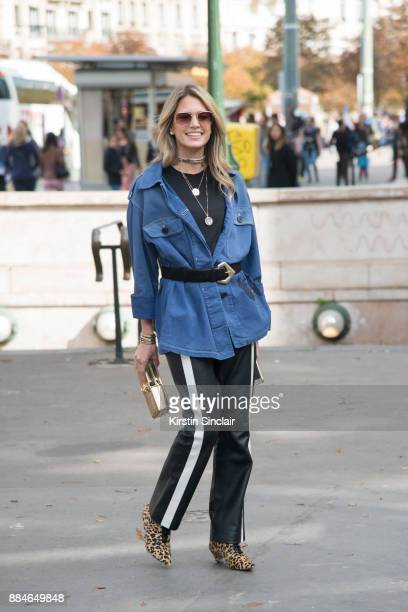 Fashion blogger Helena Bordon wears a Dior jacket and boots Dolce Gabbana bag Mugler trousers and Helena Bordon sunglasses day 5 of Paris Womens...