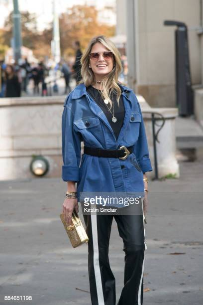 Fashion blogger Helena Bordon wears a Dior jacket Dolce Gabbana bag Mugler trousers and Helena Bordon sunglasses day 5 of Paris Womens Fashion Week...