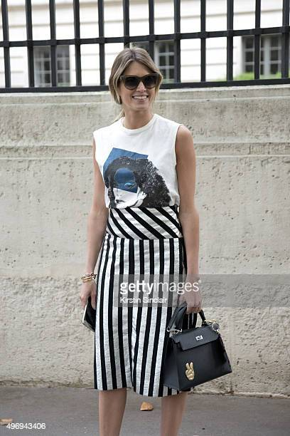 Fashion Blogger Helena Bordon wears a NK Store top and skirt Hermes bag and Celine sunglasses on day 6 during Paris Fashion Week Spring/Summer...