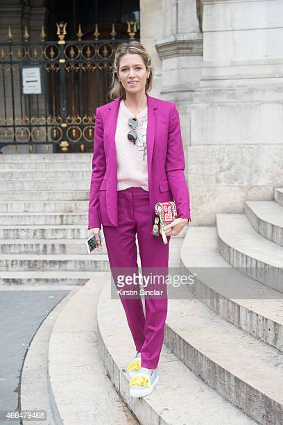 Fashion blogger Helena Bordon wears a Stella McCartney suit LâF shoes Paola Cademartori bag and Fendi sunglasses on day 7 of Paris Collections Women...