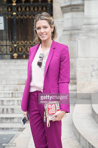 Fashion blogger Helena Bordon wears a Stella McCartney suit Paola Cademartori bag and Fendi sunglasses on day 7 of Paris Collections Women on March...