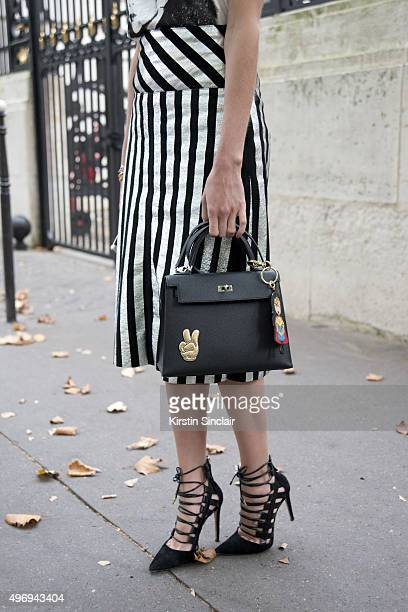 Fashion Blogger Helena Bordon wears Aquazurra shoes NK Store top and skirt and Hermes bag on day 6 during Paris Fashion Week Spring/Summer 2016/17 on...