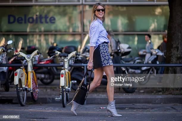 Fashion Blogger Helena Bordon wears Zara shirt Alexandre Birman shoes Costume National bag and Fausto Puglisi skirt during Milan Fashion Week...