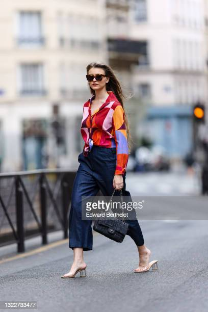 Fashion blogger @hippolyt.e wears sunglasses from Jimmy Fairly, a red pale pink purple and orange print pattern shirt from Stella Jean, navy blue...