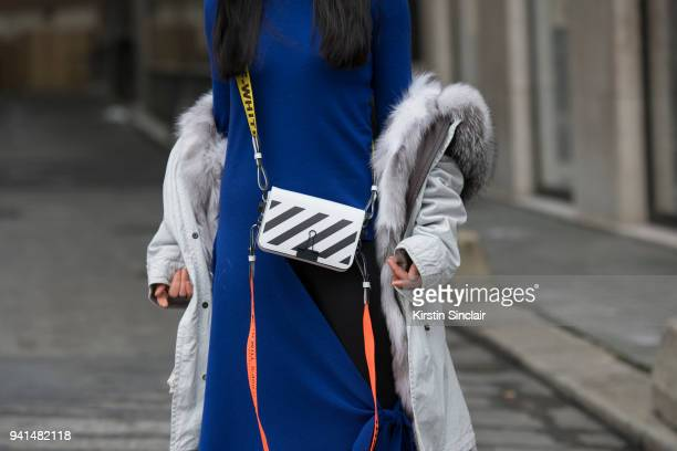 Fashion blogger Holly Pan of petiteflowerpresents wears an Off White bag MrMrs Italy jacket and a Balenciaga dress day 4 of Paris Womens Fashion Week...