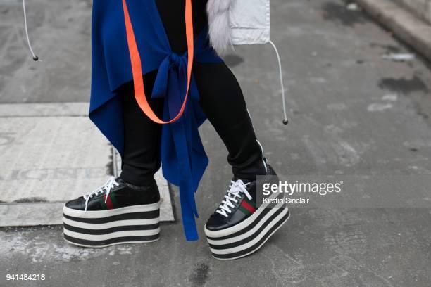 Fashion blogger Holly Pan of petiteflowerpresents wears Gucci shoes Monse trousers and a Balenciaga dress day 4 of Paris Womens Fashion Week...
