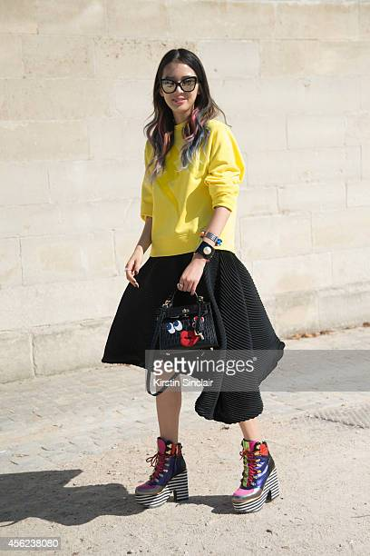 Fashion Blogger Irene Kim is wearing a Lucky Chouette top Fendi bag Issey Miyake skirt Barney's Fork and Chanel bracelet Suecomma Bonnie shoes and...