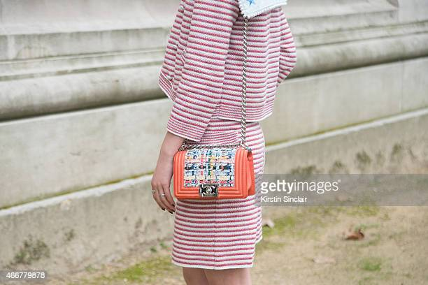 Fashion blogger Irene Kim wears a Fleamadonna suit Chanel bracelet and bag on day 8 of Paris Collections Women on March 10 2015 in Paris France