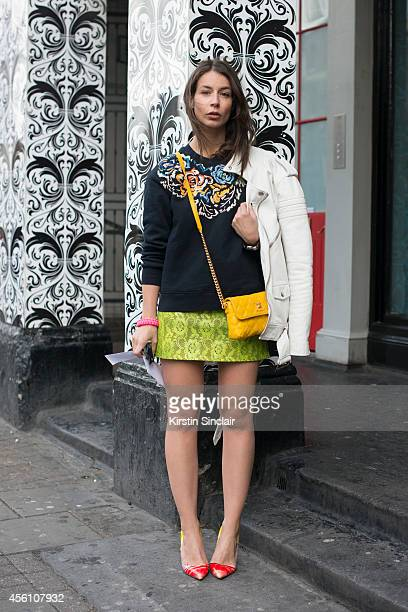 Fashion Blogger Irina Lakicevic wears a Christopher Kane skirt, Marc Jacobs bag, Christian Louboutin shoes, Full Winter Spring Summer sweater and a...