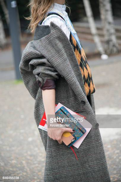 Fashion Blogger Irina Lakicevic wears Isabel Marant jacket, Miu Miu sweater on day 2 of London Womens Fashion Week Autumn/Winter 2017, on February...