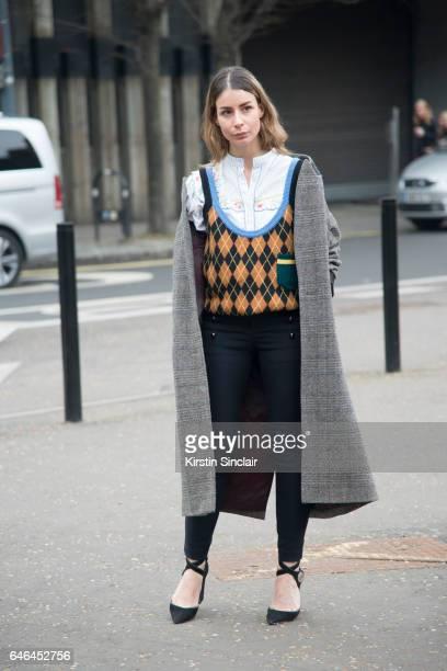 Fashion Blogger Irina Lakicevic wears Louis Vuitton shoes Isabel Marant trousers and jacket Miu Miu sweater on day 2 of London Womens Fashion Week...