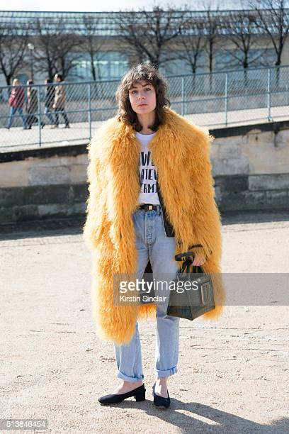 Fashion Blogger Irina Lakicevic wears Vetements coat on day 4 during Paris Fashion Week Autumn/Winter 2016/17 on March 4 2016 in Paris France