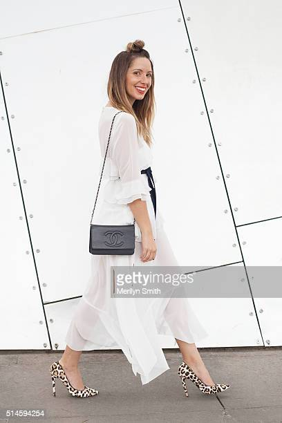 Fashion Blogger Jasmin Howell wearing a Maurie and Eve dress Chanel bag and Toni Bianco shoes during the 2016 Melbourne Fashion Festival on March 9...