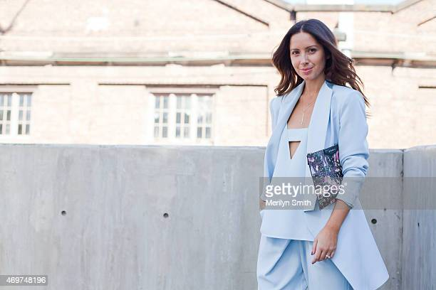 Fashion Blogger Jasmine Howell wears a FinderÕs Keepers suit and top and a Givenchy clutch at MercedesBenz Fashion Week Australia 2015 at...