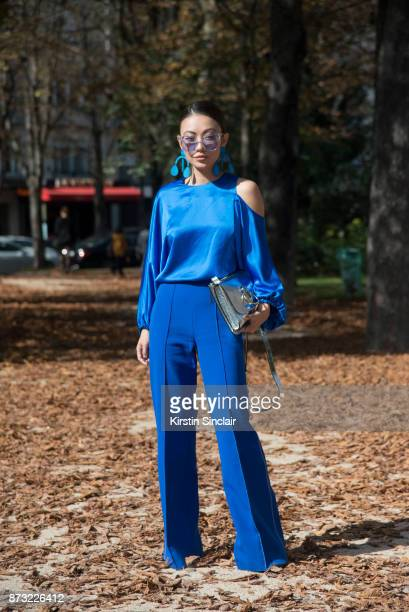 Fashion blogger Jessica Wang wears Gentle Monster sunglasses Annie Costello Brown earrings Tibi top Paper London trousers Rag Bone boots and a...