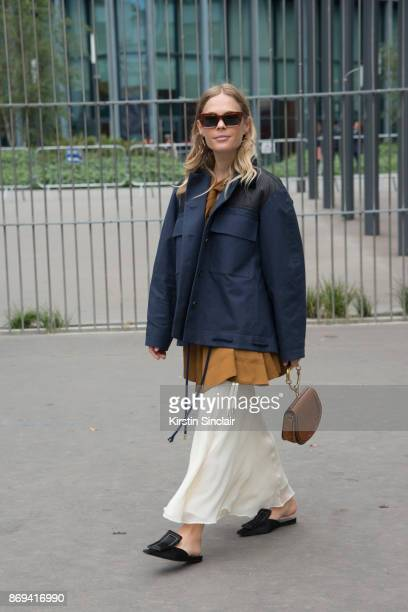 Fashion blogger Jessie Bush wears a Carven jacket skirt and top Chloe bag Celine sunglasses Marni shoes and Holly Brian earrings day 3 of Paris...