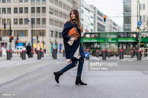 Fashion blogger Julia Haghjoo wearing COS blouse coat Max Co Zara pants Chloe bag Zalando boots during the MercedesBenz Fashion Week Berlin...