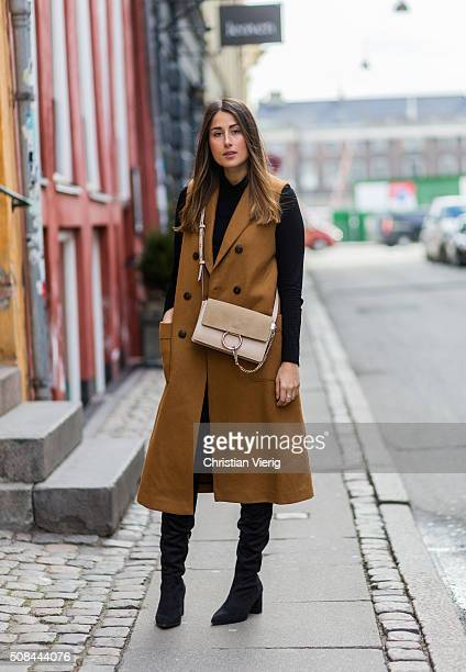 Fashion blogger Julia Haghjoo wearing Sam Edelman boots Chloe bag J Brand jeans vest and top Zara during the Copenhagen Fashion Week Autumn/Winter...